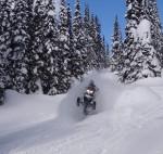 Snowmobile In deep powder